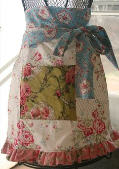Apron Revival: aprons.....love the different prints on this one. I love this one