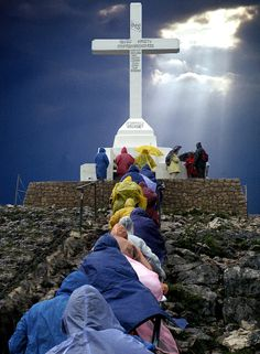 Pilgrims at Krizevac hill, Medjugorje, western Bosnia & Herzegovina. A 8 1/2m concrete cross built (1934) to commemorate the 1900th anniversary of the cross and Passion of Christ.