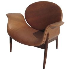 Mid Century Leather Shell Chair in the Manner of Arne Jacobsen | From a unique collection of antique and modern armchairs at http://www.1stdibs.com/furniture/seating/armchairs/