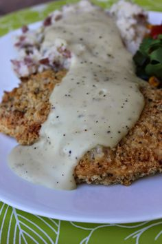 Country Fried Chicken--comfort food at it's finest! This recipe is a little lighter version than most. With the baked, panko crusted chicken and the homemade gravy made from lowfat milk, this recipe is a slightly healthier version of the traditional favorite. Perfect dinner solution for a cold, fall night! By Deals to Meals