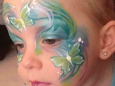 Butterfly face painting design blue green.