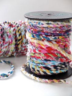 """Do you have an over abundance of fabric scraps that you are holding on to, """"just in case""""? Cintia from My Poppet was doing just that, and then she came up with the clever idea of turning her scraps into pretty twine. You can find the simple tutorial below."""