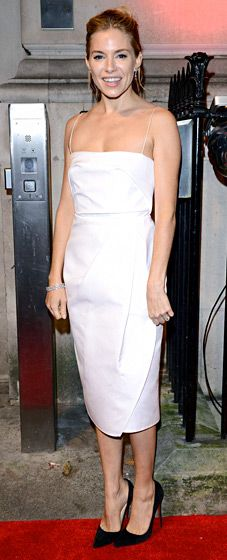 Sienna Miller in a crisp white Carven dress with spaghetti straps.