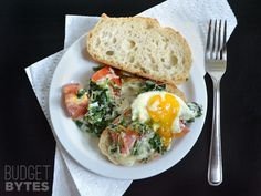 Baked Eggs with Spinach and Tomatoes – Budget Bytes – Breakfast Recipes Egg Recipes, Brunch Recipes, Chef Recipes, Breakfast Dishes, Breakfast Recipes, Breakfast Options, Spinach Egg, Vegetarian Recipes, Healthy Recipes