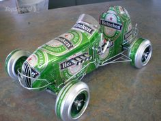 Sandy Sanderson, an artist from New Zealand creates these miniature cars out of recycled soda and beer cans. Bottoms of cans are used to make wheels and the graphics are turned into side panels and decorations for the body. Cool!
