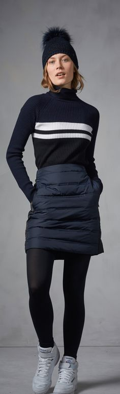 Get excited for winter with warm wintery looks like this understated navy blue down quilted skirt from Bogner Fire + Ice. Matched with warm tights, a classic and simple knit sweater and a quirky beanie with a fur bobble, you'll be in the snowy spirit in no time.