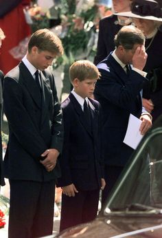 Prince Charles, with William and Harry following Diana's casket down the streets of London.