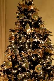 Black tree with gold ornaments