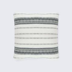 A modern take on traditional Peruvian motifs, this hand-loomed alpaca throw pillow features an intricate diamond pattern in a classic black and cream palette.