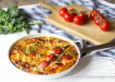 Healthy Low Carb Crustless Quiche Recipe Main Dishes, Breakfast and Brunch with free range egg, kale, swiss chard, tomatoes, shallots, whole grain mustard, garlic powder, red pepper flakes, shredded parmesan cheese, organic butter, salt, pepper