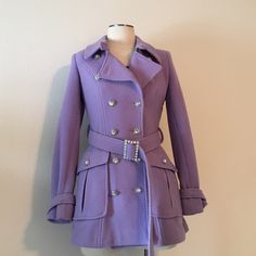 Guess by Marciano- Lavender Peacoat Size Small Guess by Marciano- Lavender Peacoat Size Small. Functional large capacity pockets, pleat back. Beautiful coat with woven detailing, satin lined. Purchased brand new but never worn. Missing one rhinestone on the buckle of the sleeve (pictured) but not noticeable because of the silver hardware. I'd hate to part with this piece but would love to find a home for it where it will be shown off with an amazing outfit.  Guess by Marciano Jackets & Coats…