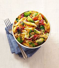 This hearty pasta is full of an array of bright textures and flavors, from salty bacon to sweet raisins.