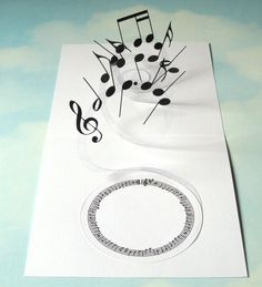 Music tumbles and trills inside this handmade pop up card. Attached to an acetate spiral the musical notes appear to fly out of the card when it is opened by the recipient. A round panel, framed by a circular stave of music, has been added to the inside of the card for your greeting. The front of the card has a simple panel with an image from a sheet of vintage music which has been layered over a square of plain black card.  This card would be ideal for a music lover on any occasion…