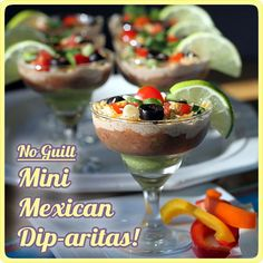 Mini Mexican Layered Dip-aritas! Great for party. Maybe in the mini Margarita glasses?
