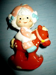 http://www.ebay.com/itm/Vintage-Strawberry-Shortcake-Apricot-on-Rocking-Horse-Christmas-Ornament-1982-/351170888668?pt=TV_Movie_Character_Toys_US&hash=item51c36a83dc