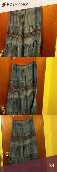 Denim skirt Denim maxi skirt with brown trim , slight tear in waist trim , if interested I will send you a detailed pic. Very comfortable.  Waist is elastic/stretch Let me know if you are interested or have questions , just trying to start off the new year with less shit ???? P.s. I am a misfit ( ari fitz fans put your pinkies in the air) Skirts Maxi