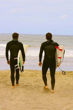 Surfers heading out to the water