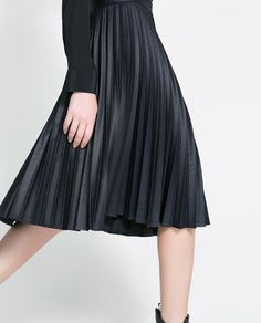 I wonder how this coated skirt looks and feels irl. Love that it's navy and not black.