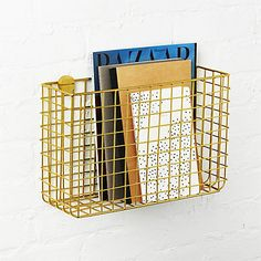 Handcrafted from iron wire, modern grid finished in bright brass hangs on the wall to collect mail/magazines in the entry or supplies, etc in the office. Grid Brass Magazine Rack is a exclusive.
