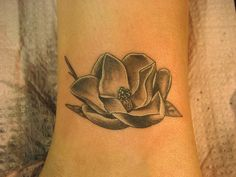 I've always wanted a tattoo of a Magnolia flower but never found a photo or drawing I liked until this one.  I love this!
