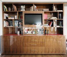 Bar Shelf - Books and a TV arranged in a media center.
