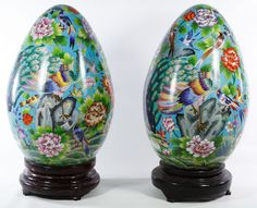 Lot 441: Asian Cloisonne Eggs; Pair of contemporary egg figurines on wooden stands with stylized bird and floral motif