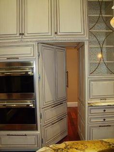 secret pantry door blends with cabinetry - Google Search