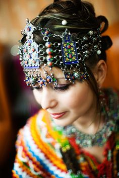 An Algerian bride wearing a traditional Berber wedding headpiece