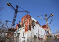 Reactor 5 of the Chernobyl nuclear power plant.  This reactor was 6 weeks away from being completed at the time of the disaster - all work was stopped.  After 29 years, the cranes are currently carefully being dismantled.