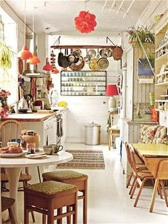 I like how they used a neutral canvas & added lots of color with decorative items. I always say it's easier to replace a lamp shade or buy colorful new canisters than it is to repaint and tile a room :p - via UK Telegraph
