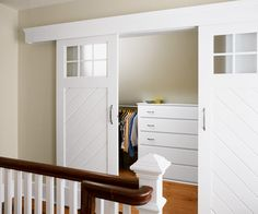Barn-style sliding doors close off a walk-in closet outfitted with built-in dressers built by the homeowner. |  Photo: Eric Roth | thisoldhouse.com