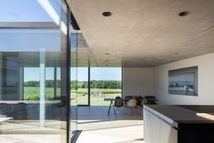 Dwell - Defying traditionalism: concrete bungalow inserted in a rural Belgian landscape
