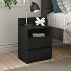 Featuring a modern design with plenty of display and storage options, this bedside table brings substance as well as style. A streamlined square cut gives way to a few details of blocky texture for a contemporary look and there are two separate display sections. The surface with its headboard is great for lighting, houseplants, art and photos while the shelf offers a perfect place for bedside reading. Two drawers rest on roller glides. Assembly is required.