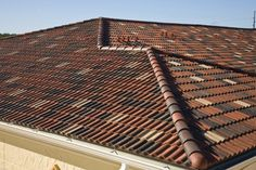 Tile roofs don't just come in the classic terra cotta color! Try using a variety of coordinating colors for a roof that truly stands out from the rest!