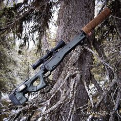 Suppressed bolt action rifle