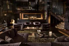Design firm Dodd Mitchell used shag carpeting, velvet-upholstered chairs and brass accents to create this louche seating tableau for the now-defunct MyHouse nightclub in Hollywood.
