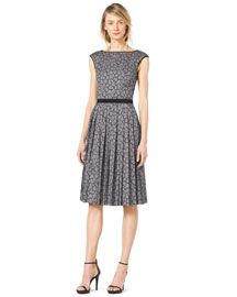 Michael Kors Boat neckline. Cap sleeves. Fitted bodice; solid waistband. Pleated A-line skirt. Cotton/spandex.