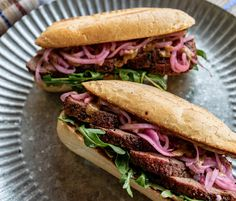 Grilled Tri-tip sandwiches with pickled onions, arugula and mustard sauce Tri Tip Steak Sandwich Recipe, Steak Sandwiches, Tri Tip Grill, Sandwich Sauces, How To Make Sandwich, Pickled Onions, Cooking On The Grill, Food Places, No Cook Meals