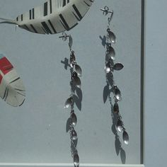 "Sterling silver earrings Graceful sterling silver earrings with 3.25 in drop. Chain with silver ""leaves"" has elegant movement when wearing. Mild tarnishing. Stamped 925. Jewelry Earrings"