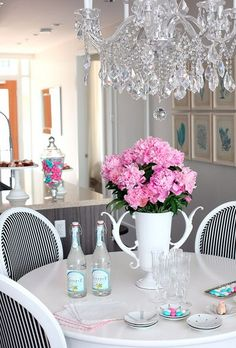 Black and white chairs, round white kitchen table, chandelier