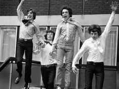 Pink Floyd leap with joy, having signed a record deal with EMI in 1967.