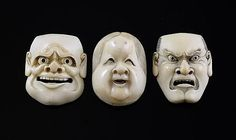 Three Japanese ivory noh mask netsuke, 19th century, in the form Okame and two male characters, 4.1 - 4.4cm.