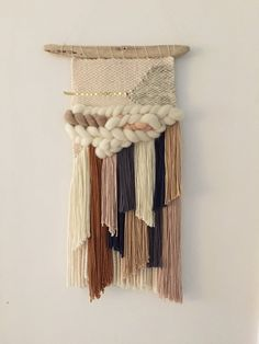 Handmade woven wall art hung on a 14 long piece of driftwood, hangs approximately 24 long, and measures 11 wide at its widest point. Available to ship 1/19