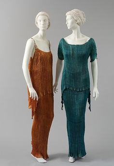 Design House: Fortuny  Designer: Mariano Fortuny Culture: Italian Medium: silk, glass Evening Dress Accession Number: 1980.170 (on the left) Evening Dress Accession Number: C.I.58.61.4 (on the right)