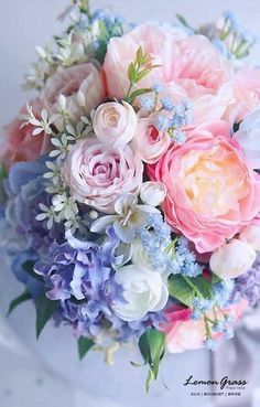 Pastel multicoloured bouquet in pale pinks, blues and white.Such a beautiful palate Bouquet for a spring wedding.New flowers wedding spring pastel bouquet IdeasLet Celebrate at Snug Harbor host your next special event! Rose Bridal Bouquet, Bridal Flowers, Silk Flowers, Flowers Garden, Garden Loppers, Peonies Garden, Pastel Flowers, Pastel Floral, Art Floral