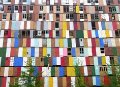 """A South Korean artist used 1000 recycled doors to create a """"construction shield"""" that doubled up as an interesting visual point in an urban centre."""