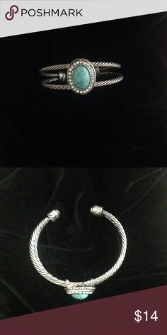 Silver and turquoise bracelet Turquoise and silver twist bracelet.. Rhinestone detail around the stone. Jewelry Bracelets