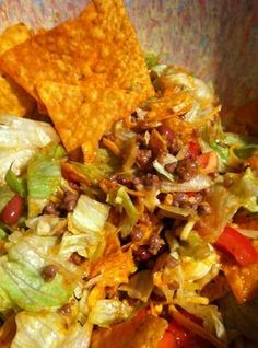 Dorito taco salad. One of my favorites! Keep in mind that this does not keep well after adding the chips. I've always used taco-flavored Doritos. Corn chips work, too. The recipe doesn't say, but this is served cold.