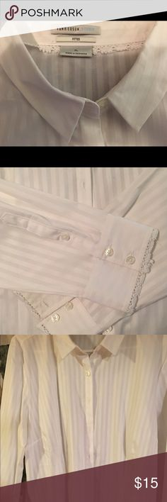 Van Heusen fitted button down shirt NWOT long sleeve fitted shirt. It is kinda a white on white pinstripe. Very pretty. Never worn, just took the tags off and hung it up a few months ago. Van Heusen Tops Button Down Shirts