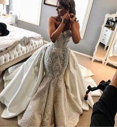 This ornate couture wedding gown can be recreated for you as shown or with any design changes. This elegant strapless bridal gown has a detachable ball gown overskirt. We can make custom #weddingdresses like this for a reasonable price. Our firm also makes inexpensive #replicas of haute couture #dresses too. So if what you want is out of your price range email us the pictures. DariusCordell.com